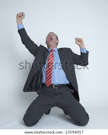 Businessman falls to his knees in celebration! - stock photo