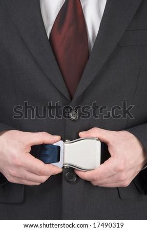 Businessman Fastening Safety Belt - stock photo