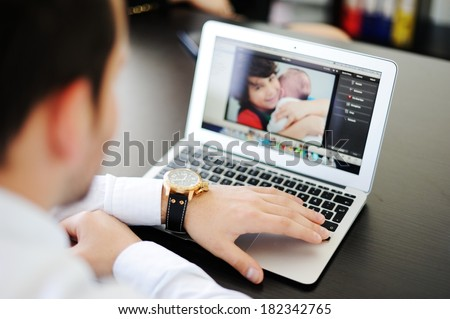 Businessman father talking to his family from the office - stock photo