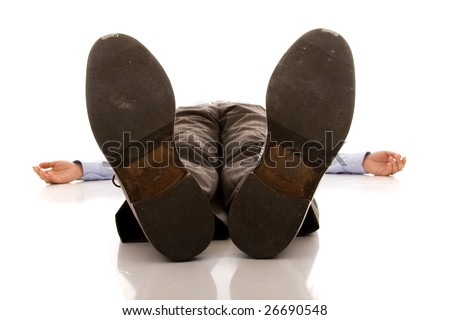 businessman feet of a dead body (isolated on white) - stock photo