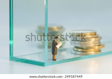 Businessman figurine planning about retirement pension - stock photo
