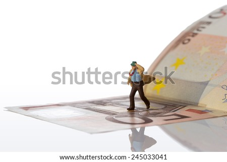 businessman figurine running on a euro banknote,white background with clipping path - stock photo