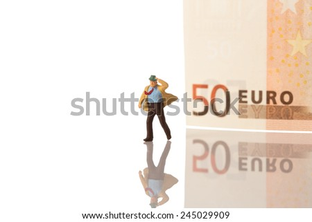 businessman figurine running with euro banknote background,isolated on white with clipping path - stock photo