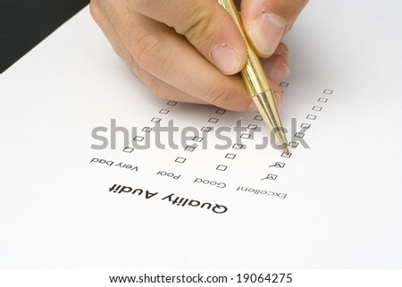 businessman filling out a questionnaire quality of service - stock photo