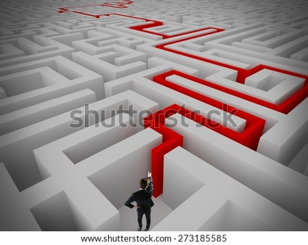 Businessman find the exit of a maze - stock photo