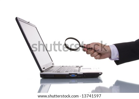 businessman finding data in a laptop - stock photo