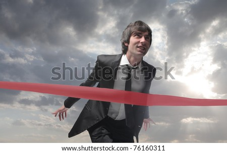 Businessman finishing a race - stock photo