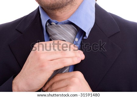 Businessman fixing his tie, isolated on white - stock photo