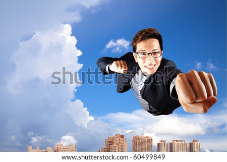 businessman fly in sky over the city - stock photo