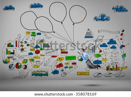 Businessman fly on balloons