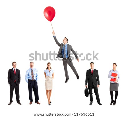 Businessman flying away from his team