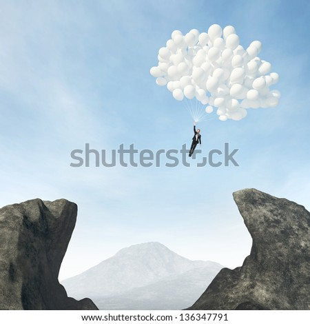 Businessman flying on balloons - stock photo