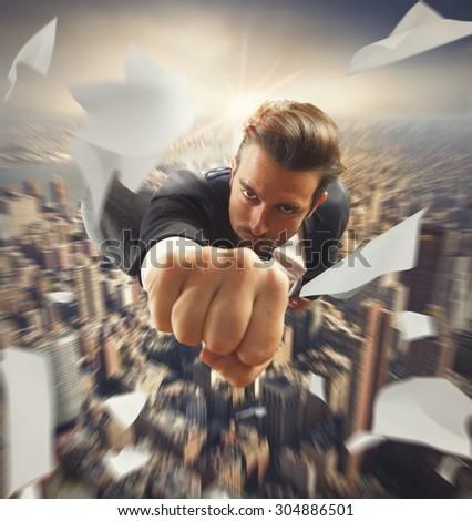 Businessman flying over the city like superhero - stock photo