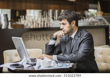 businessman freelancer working at the coffee shop