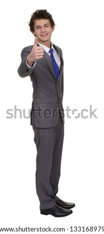 Businessman full length isolated with a thumbs up sign, selective focus on thumb.