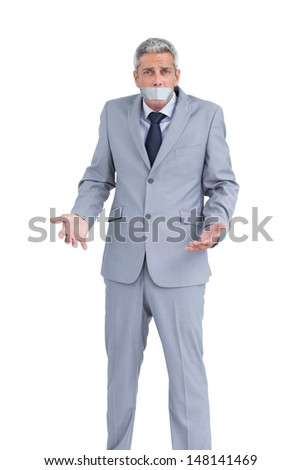 Businessman gagged with adhesive tape on mouth on white background - stock photo