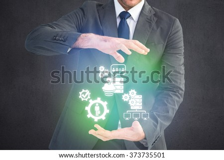 Businessman gesturing with his hands against grey room - stock photo