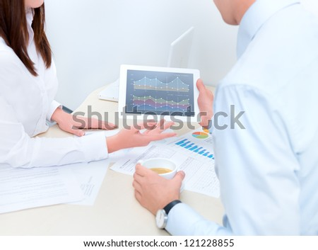 Businessman getting advice from a financial analyst. - stock photo