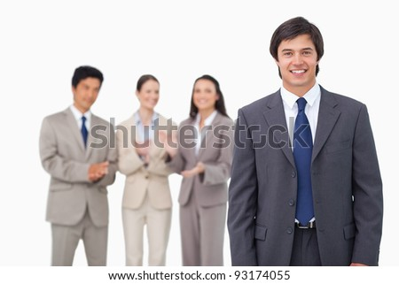 Businessman getting applause from colleagues against a white background - stock photo