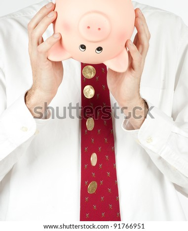 businessman getting money from a piggy bank - stock photo