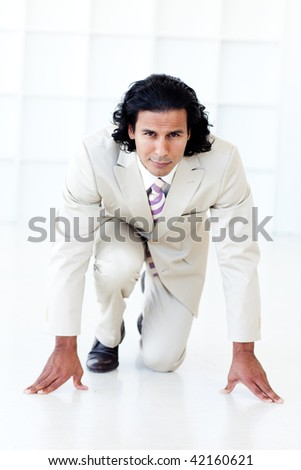 Businessman getting ready for a race against white background - stock photo