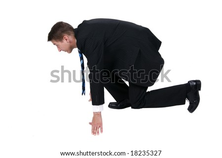Businessman getting ready for race in business - stock photo