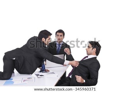 Businessman getting violent with fellow businessman - stock photo
