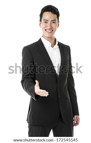 Businessman giving a hand shake - stock photo