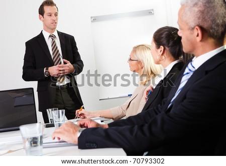 Businessman giving a presentation - stock photo