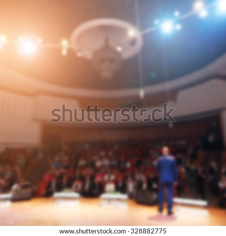 businessman giving a presentation in a conference/meeting  - stock photo