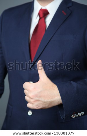businessman giving a thumb up
