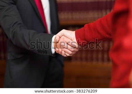 Businessman giving an handshake to a customer - stock photo