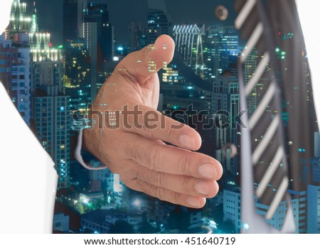Businessman giving him hand for handshake to partner with city background. Concept of Agreement, Partnership, Teamwork, Welcome, Congrats,Business deals and Collaboration.  - stock photo