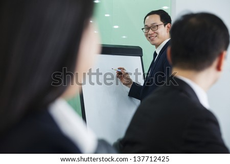 Businessman Giving Presentation - stock photo