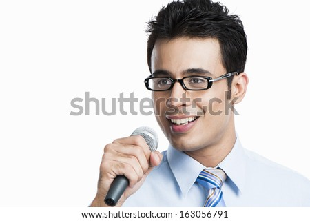 Businessman giving speech into a microphone