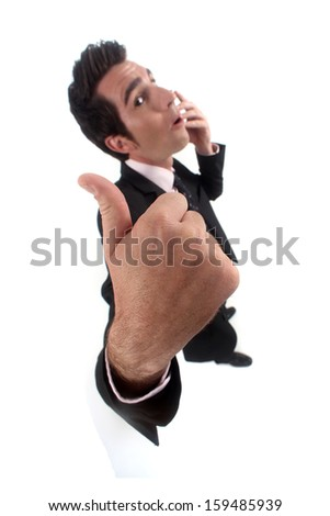 Businessman giving the thumb's up - stock photo