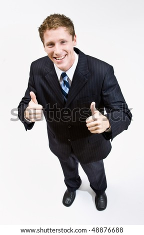 Businessman giving thumbs up gesture - stock photo