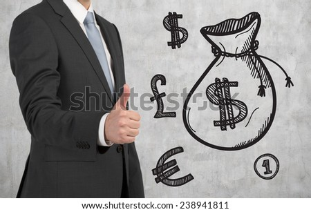businessman giving thumbs up sign and drawing money bag