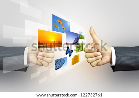 Businessman giving thumbs up to stock photos