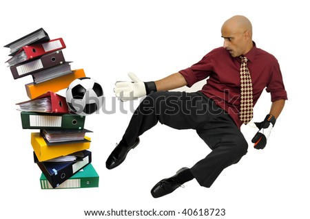 Businessman goalkeeper with gloves and ball in a goal made of files  isolated in white