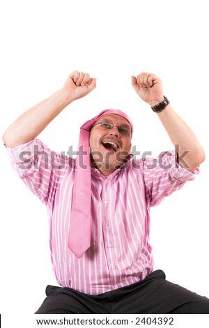 Businessman going all wild with his tie wrapped around his forehead and his arms in the air - stock photo
