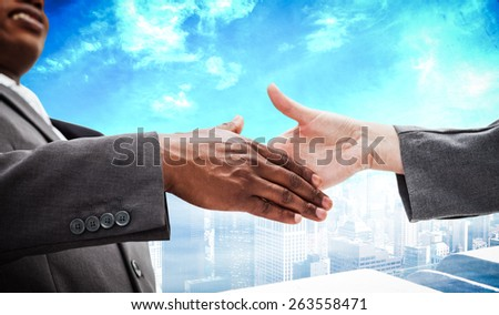 Businessman going shaking a hand against high angle view of city - stock photo