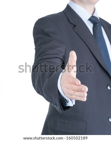 Businessman going to shake your hand - stock photo