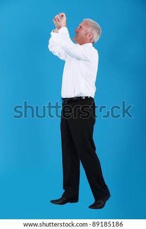 Businessman gripping empty copyspace - stock photo