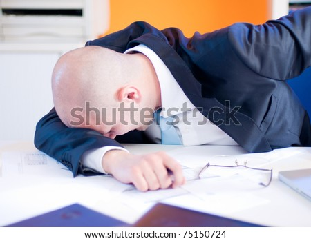 Businessman had a hard day in the office - stock photo