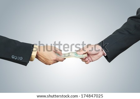 businessman hand and money to other for corruption concept - stock photo