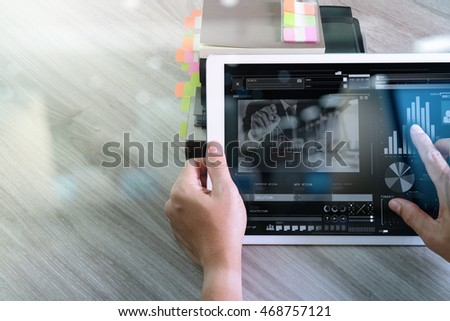 Businessman hand attending video conference with digital tablet computer at desk in office
