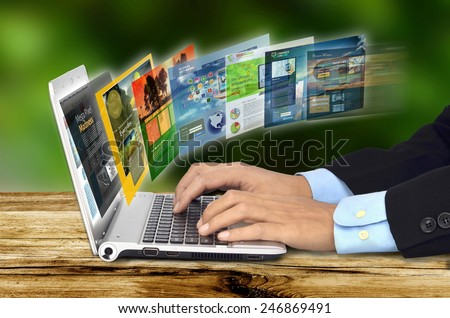 Businessman hand browsing internet websites on his laptop - stock photo