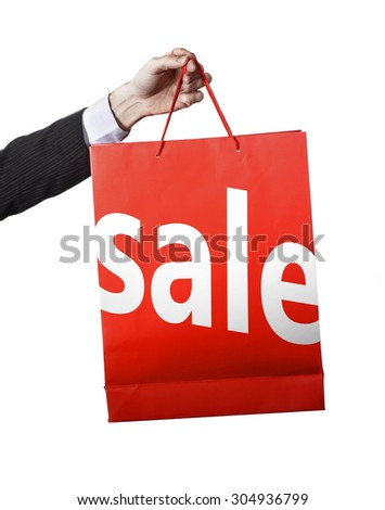 businessman hand carrying and showing a Red Shopping Bag announcing sale on white big letters isolated on white background in satisfied customer concept