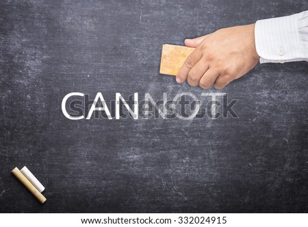 Businessman hand changing the word cannot to can. Alphabet N, O, T being erased from a chalkboard. Change concept. - stock photo